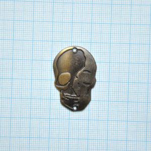 бирка в форме черепа